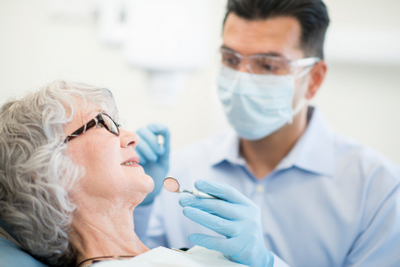Elderly woman being treated at Dr. Julie Phillips Prosthodontics in Greensboro, NC